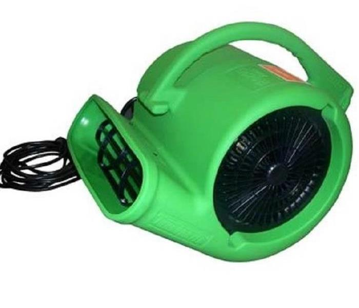A green circular fan shaped like a snail